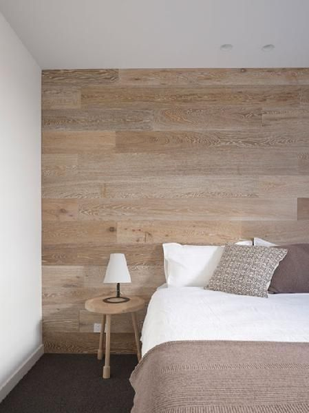 Laminate flooring on walls- warm up a room, especially with concrete floors