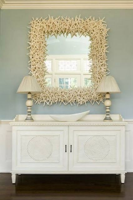 Stunning starfish!  Here would be a reason to make the urethane starfish mold. Make dozens of plaster starfish for this mirror.