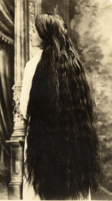 vintage photo of a woman with very long and thick hair...