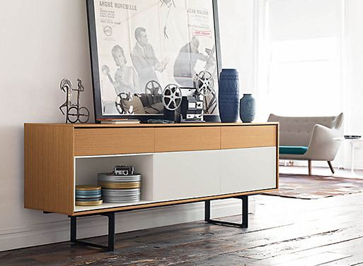 You've seen the Aura Media Unit featured here before, but this is the Aura Credenza and it might just be the answer to your storage issues. Wood veneer and lacquer mix well for contrast, and the th...