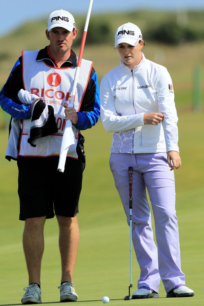 Caroline Masson Photos Photos - Caroline Masson of Germany lines up a putt on the 6th green with caddie Martin Ridley during the third round of the 2011 Ricoh Women's British Open at Carnoustie on July 30, 2011 in Carnoustie, Scotland. - Ricoh Women's British Open - Day Three