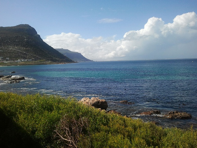 Lazily watching the ocean roll by on the train home after fish and chips and beer at the Salty Sea Dog - Simon's Town, South Africa