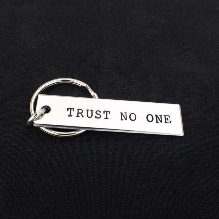 "This ""Trust No One"" key chain is hand stamped with care, one letter at a time…"