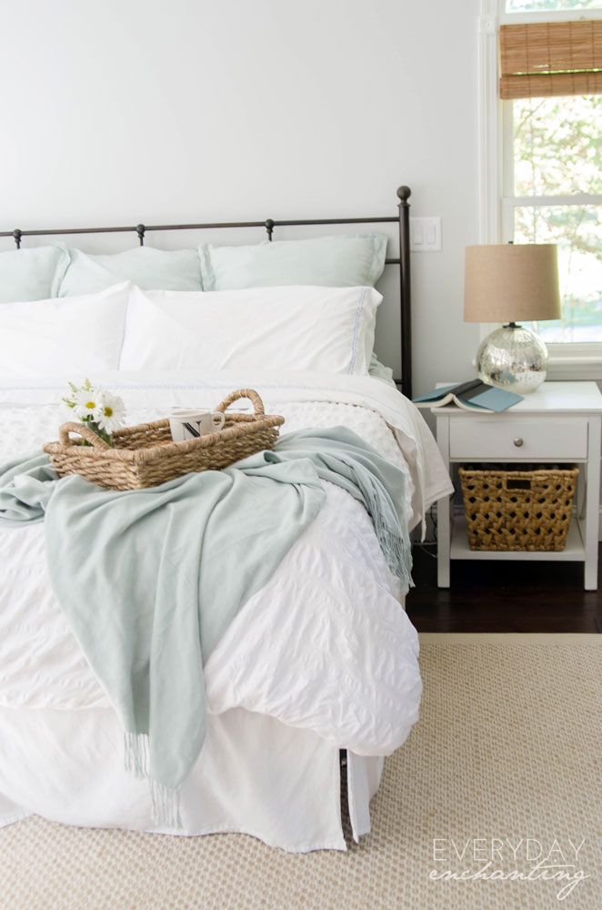 Love the pastel pop of color in an otherwise neutral palette. Sources: Headboard - Birch; Paint Color - Benjamin Moore Wickham Gray; Euro Pillow Covers, Rug, Cashmere Throw - Pottery Barn; Duvet Cover, Nightstand, Lamp, Basket Tray, Bedskirt - Target; Mug - Anthropologie; Basket Under Nightstand - Homegoods