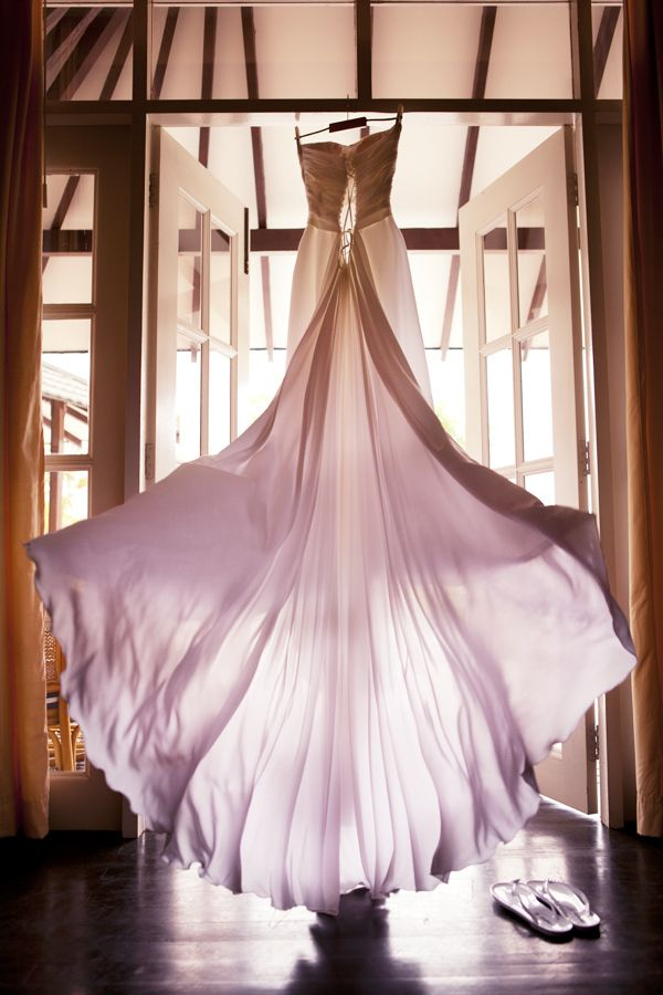 beautiful wedding dress flying on a wind in Maldives  Photography by TropicPic  #maldives #wedding #dress Click the picture to see the whole photoshoot!