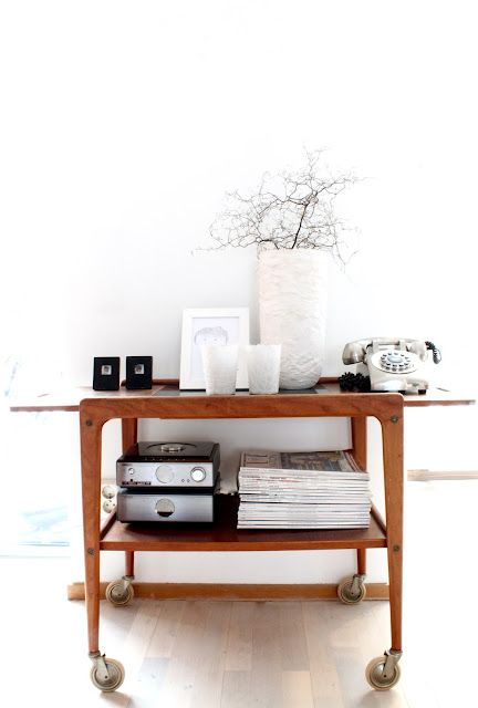 <3 everything about this! The mid century bar trolley, the silver telephone, the styling. From myscandinavianhome.blog