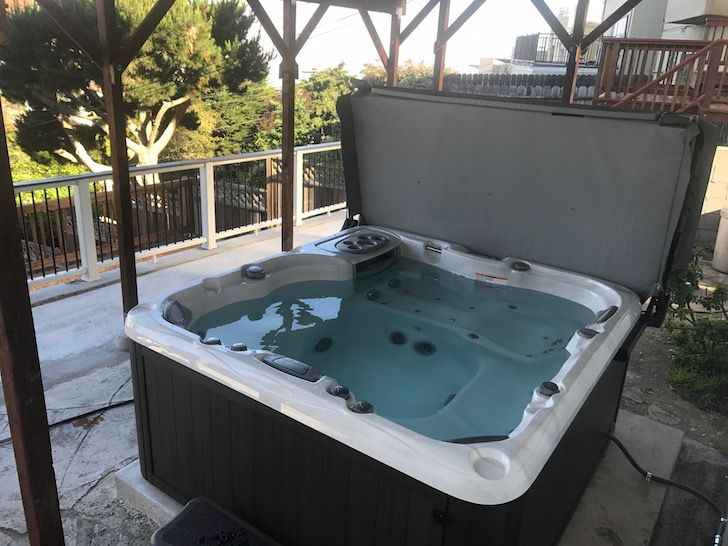 Hot Tub Economics The Cost To Own And Maintain A Hot Tub Hot Tub Backyard Hot Tub Tub