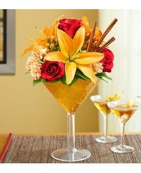 Celebrate the season with the 1800 Flowers Martini Pumpkin Spice Bouquet! A tribute to Autumn, this arrangement is fun, festive, and perfect for occasions that call for celebrations. Send as a birthday gift or as a congratulations, or simply just because!