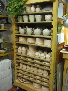 Homemade Rolling  Shelves - Sided with Pegboard.  Could be used in   Gardening-for herbs/drying, Garage / Wood Shop, Pottery,  Kitchen-baking big scale,  Kids- toy builds / board games...