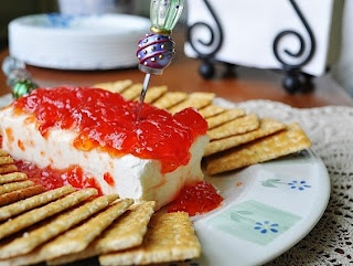 Red Pepper Jelly Cream Cheese is one of my all time favorite pacifiers.  It will keep for a while in the fridge so it's easy to keep on hand for surprise visits.  Even people that don't like #redpepperjelly or #creamcheese usually love it. http://www.hersheysparks.com