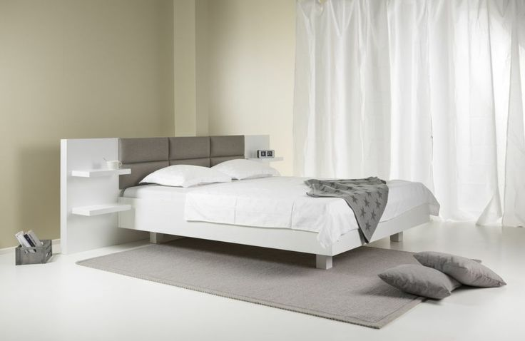 Waking up on a Sunday morning in your crisp sheets, coffee in bed, no hurry to get anywhere.. Kosketus bed with textile head of the bed.