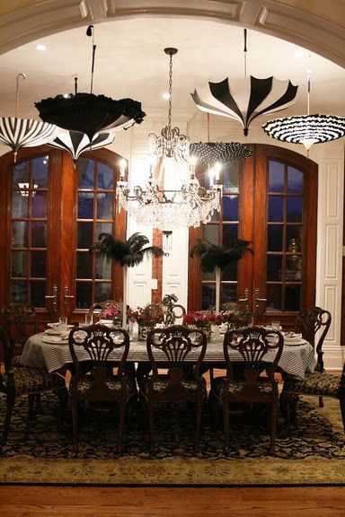 ♥ wonderful idea ~ Paris soiree theme party.  Hanging umbrella upside down from the ceiling.