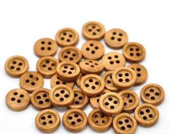Dark Brown Coffee Wooden Buttons - Large - 4 hole - 35mm - 1 1/8 inch You will be getting 20 pieces of these beautifully crafted Dark Brown Coffee wooden buttons suitable for your sewing, scrapbooking, knitting, or craft project.  What our customers are saying about these dark brown wood buttons:  Great quality and fast shipping. Love these giant buttons! Thank you!!  What you will receive:  20 - Large Wood Button Diameter: 35mm - 1 3/8 inch Color: Dark Brown Coffee  We will ship yo...