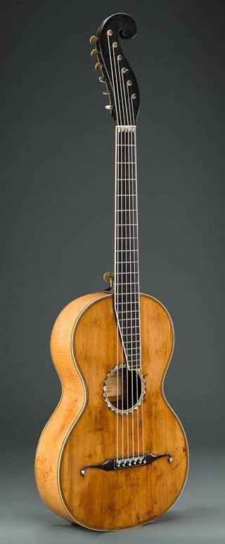 """An 1834 spruce, maple, ebony, ivory and mother-of-pearl guitar built by C.F. Martin, c. 1834, shortly after the legendary guitar maker opened his business in New York City. The artistry and craftsmanship of these early instruments are featured in a new exhibition at New York's Metropolitan Museum of Art, """"Early American Guitars: The Instruments of C. F. Martin."""""""