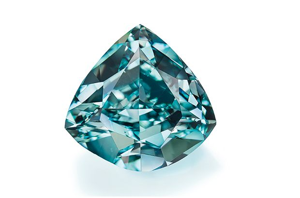 """The Ocean Dream,"" a 5.50-carat triangular-cut fancy vivid blue-green diamond, set a new world auction record for highest price paid for a blue-green diamond when it sold for $8.6 million to a private Asian buyer."
