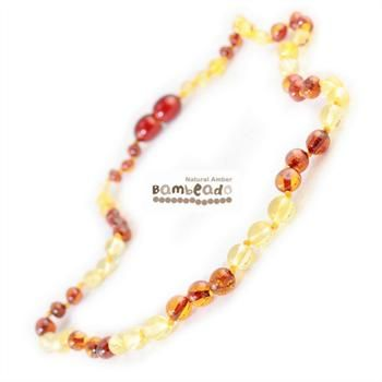 Wearing this amber necklace might assist with baby teething or if your baby has eczema.This premium amber necklace comes in a combination of lemon and cognac amber beads. Amber beads are finished in a polish compared to the standard bud range. The amber necklace is approx 32-34cm in length. Bambeado amber is genuine baltic amber. Bambeado's are to be worn and not chewed. Each bead is individually knotted to help with safety. The Bambeado comes together with a plastic screw clasp.