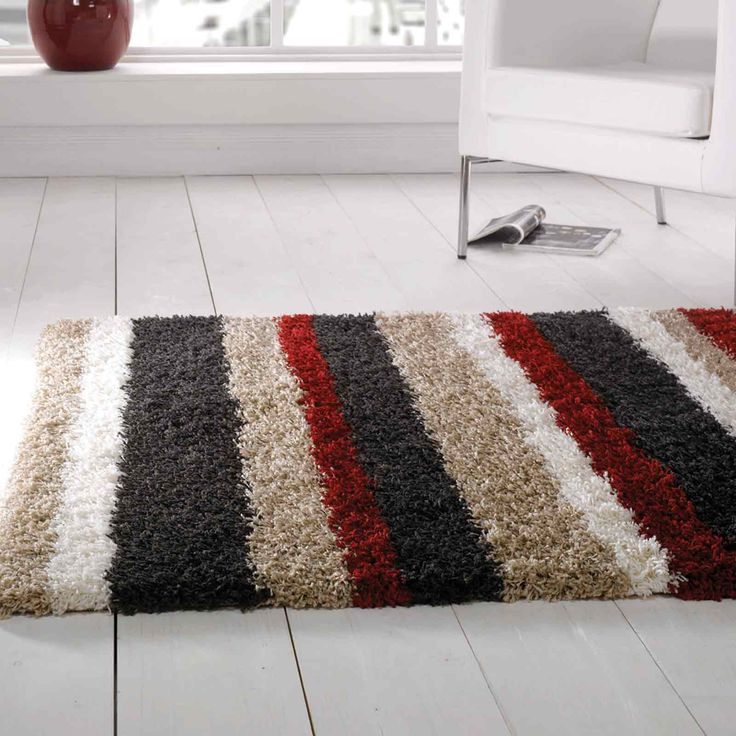 The Nordic Channel Rug In Red Brown And Cream Is Loomed Belgium With
