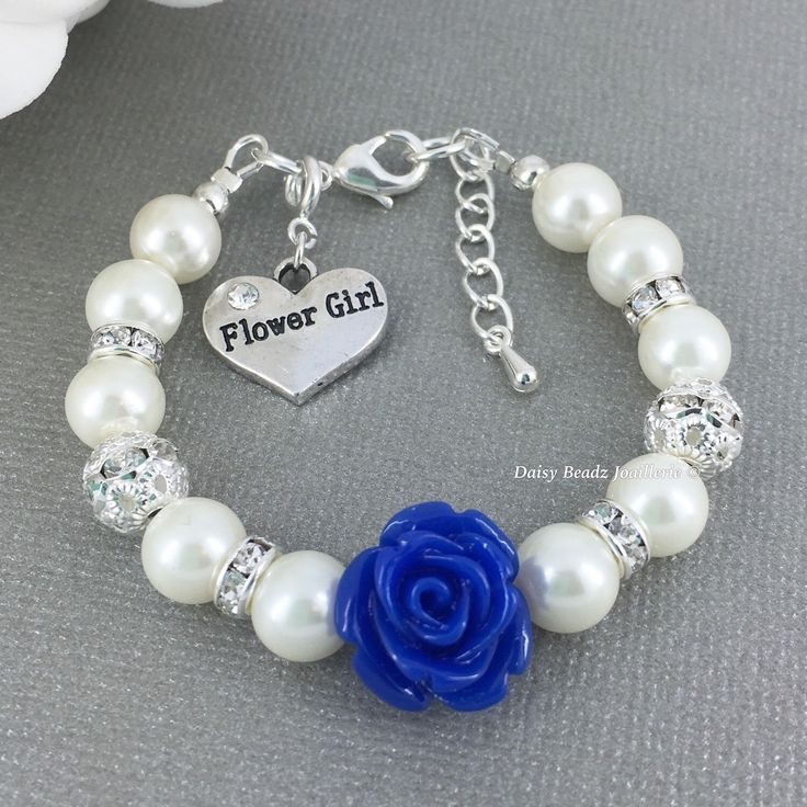 Royal Blue Flower and Ivory Pearl Bracelet, Flower Girl Jewelry, Flower Girl Gift, Ivory Bracelet, Children Bracelet, Royal Blue Wedding by DaisyBeadzJoaillerie on Etsy https://www.etsy.com/ca/listing/290295239/royal-blue-flower-and-ivory-pearl