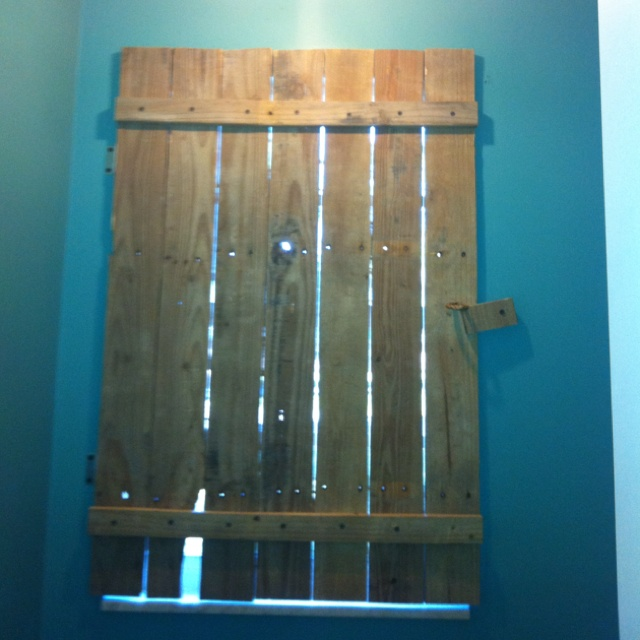 Window shutter we made out of pallets outside the house for How to make shutters from pallets