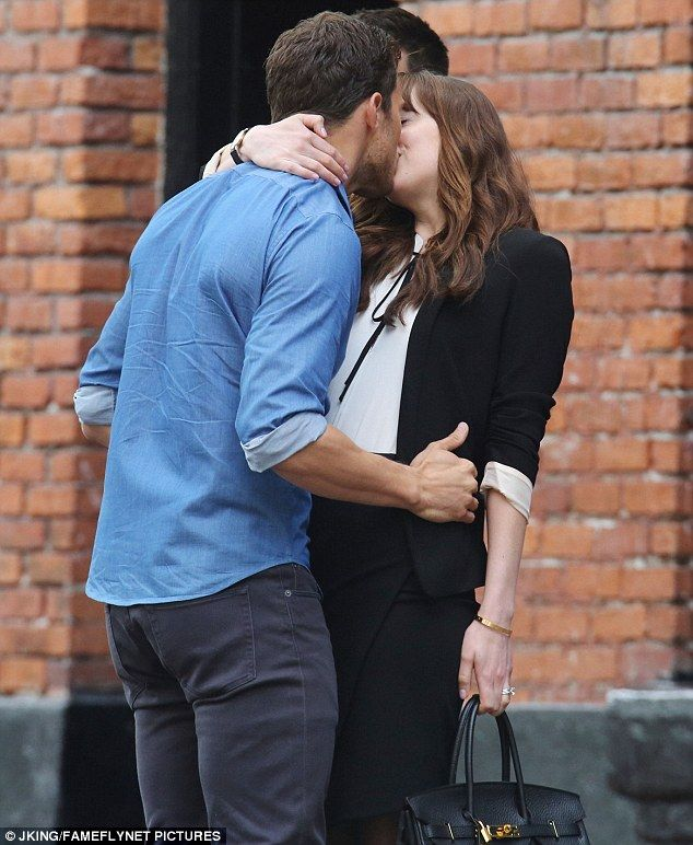 Pucker up: Jamie Dornan and Dakota Johnson were spotted kissing on the set of the Fifty Shades films in Vancouver on Monday