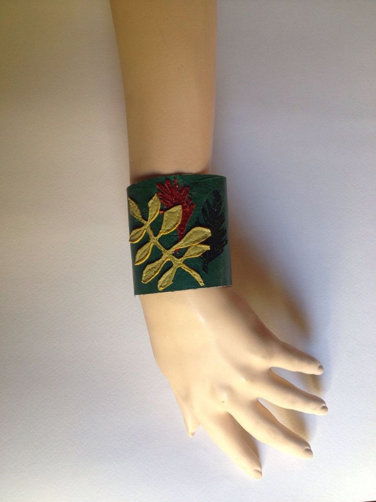 A personal favorite from my Etsy shop https://www.etsy.com/listing/493686931/tropical-plant-cuff-braceletleather
