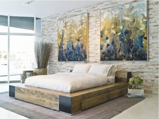 love this space - earthy artwork and accessories + great bed base