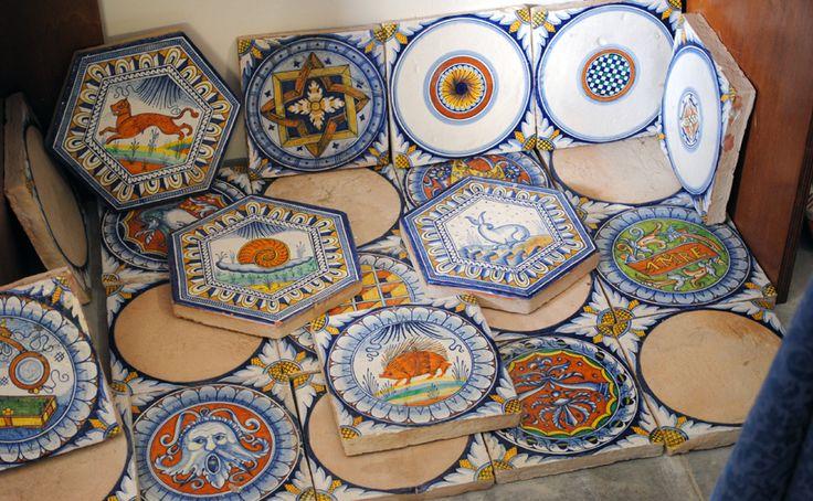 Hand painted ceramic tiles in our showroom. Mattonelle in ceramica decorate a mano nella nostra sala campionaria. #italianceramics #handmade #madeinitaly #tiles