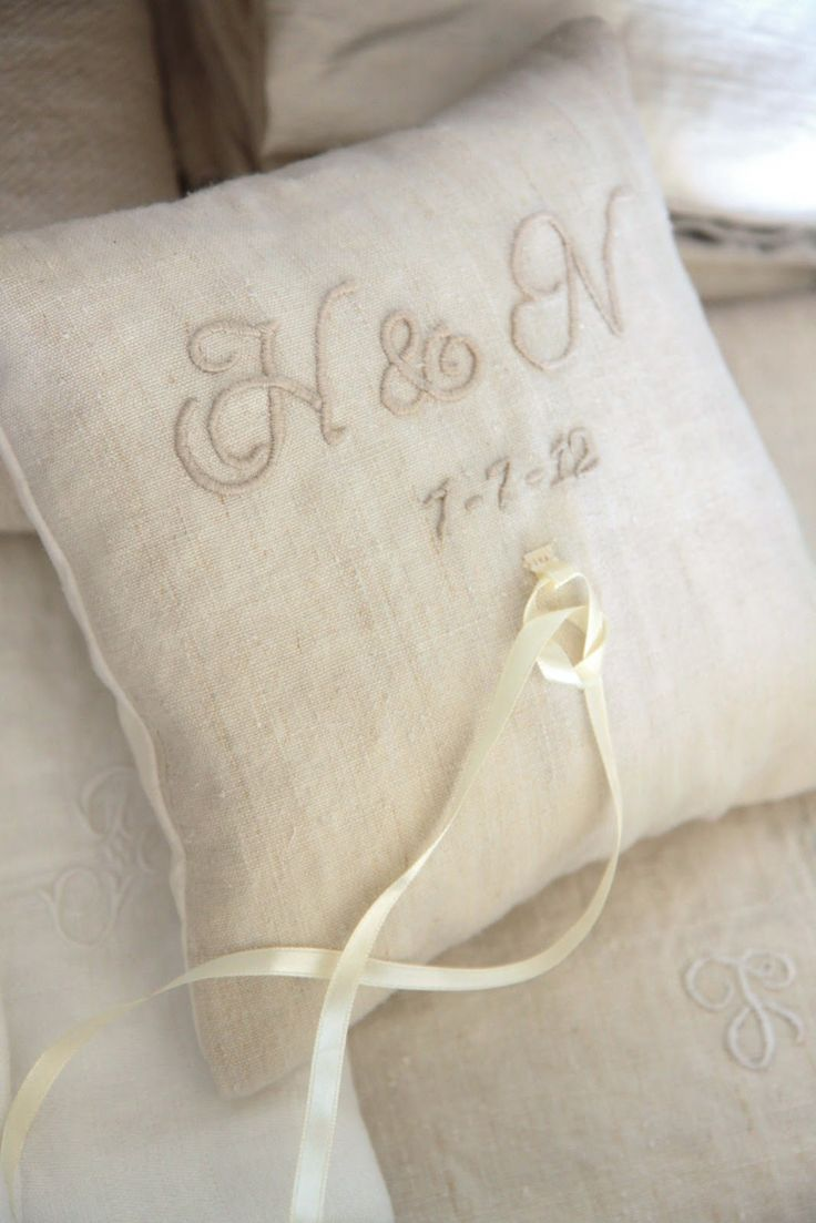 Ring-bearer: initials embroidered linen pillow (possibility that could be used, like forever)