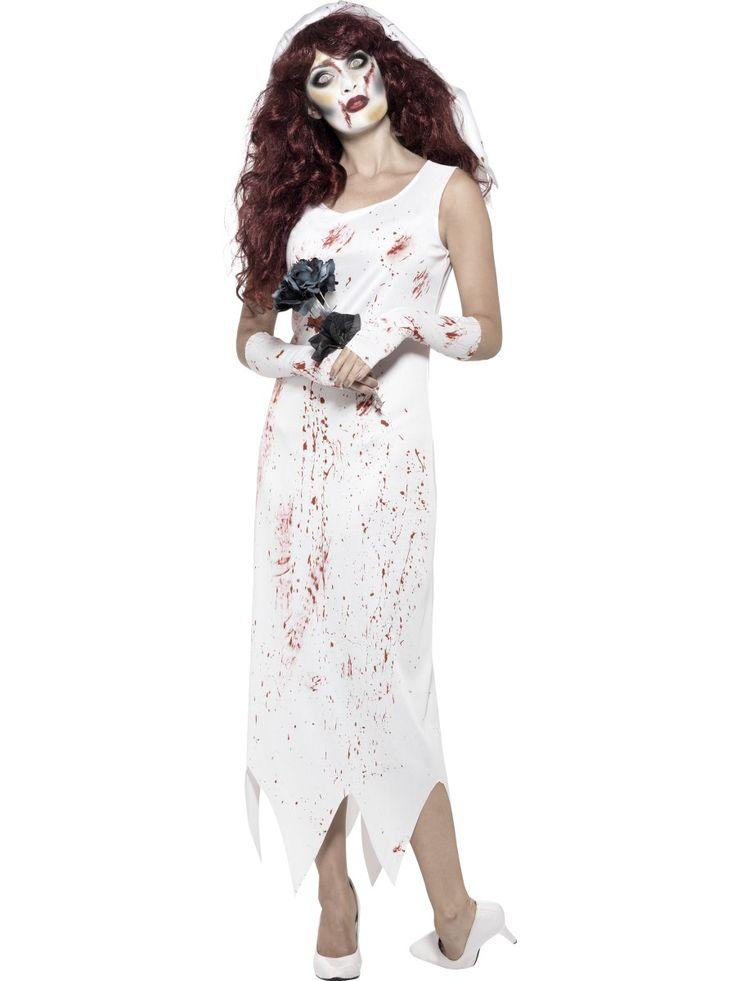 Zombiemorsian. Valkoinen naamiaisasu on verentahrima ja hieman repaleisen oloinen, kuten zombietyyliin kuuluukin.