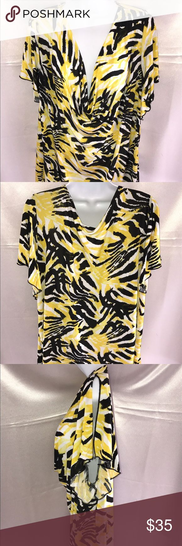 Black and yellow short sleeves top Nice and light summer top, great for traveling and summer activities Tops Tunics