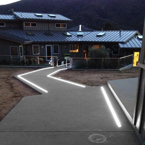 In Ground Extrusions Light Up This Concrete Pathway In