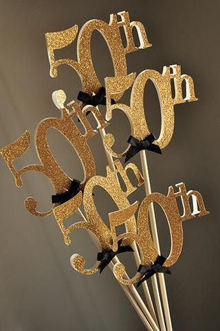 Love these glitter gold 50th wands! They will be perfect to add into our floral centerpieces!