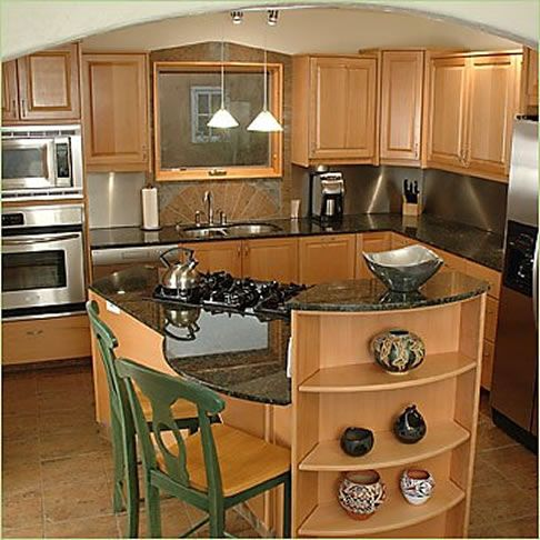 Like curved island, stove and microwave column. Did they provide counter space under the stove top? All the colors are too close in value making it bland and boring.