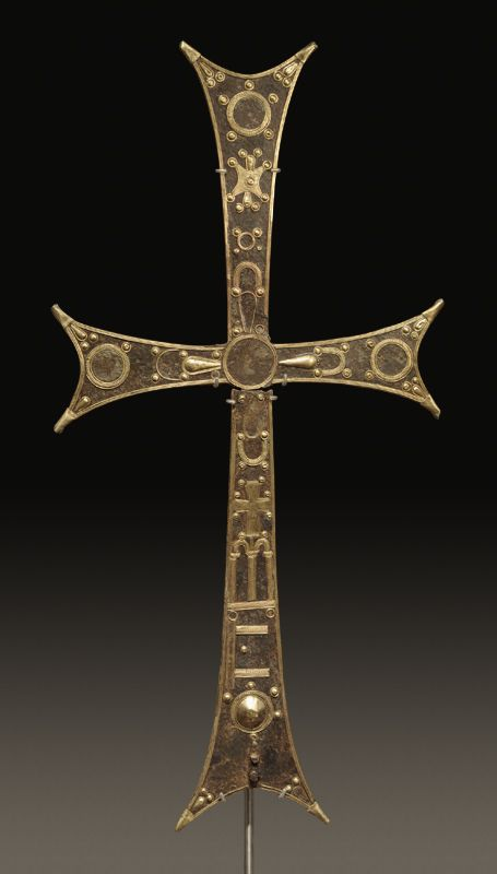 BYZANTINE LARGE IRON PROCESSIONAL CROSS  With numerous gilt bronze appliqués. Break below the crossing.  10th-12th Century AD