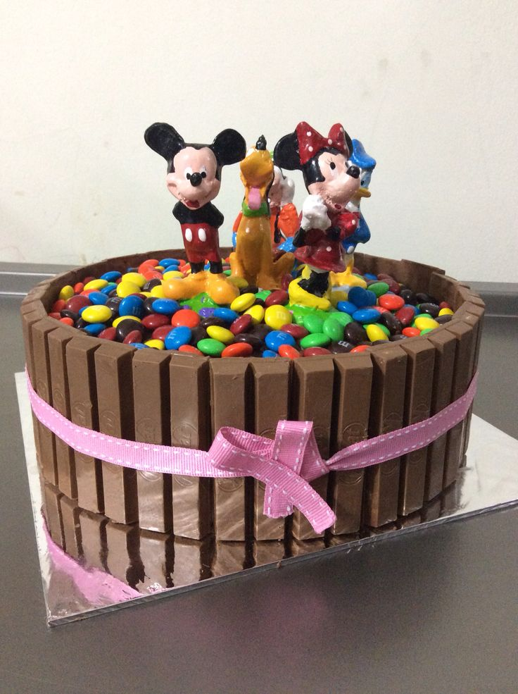 Birthday cake for my lil girl. Almond chocolate inside with MnM's chocolate and kitkat