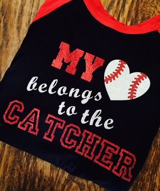 Shop now....My heart belongs to the coach, embroidered with glitter baseball heart, the perfect tee for baseball coach's wife, girlfiend, or daughter. Created on a unisex raglan, any color scheme available.  If you prefer a different type of tee, just tell us in order comments at checkout. We will contact you regarding any questions before making your tee.  Free shipping.