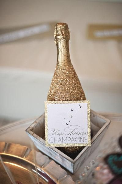 DIY New Year's Eve Ideas-Cover Champagne Bottles in Gold Glitter