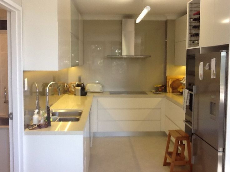Kitchen modern with integrated stainless steel rod for cookbooks &hanging untiles  Barry's Kitchens & Bathrooms