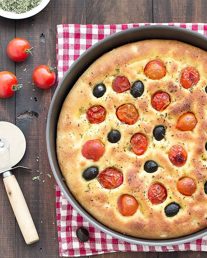A delicious Italian homemade potato focaccia with olives and cherry tomatoes. Using mashed potato gives the focaccia a super soft and tender crumb!