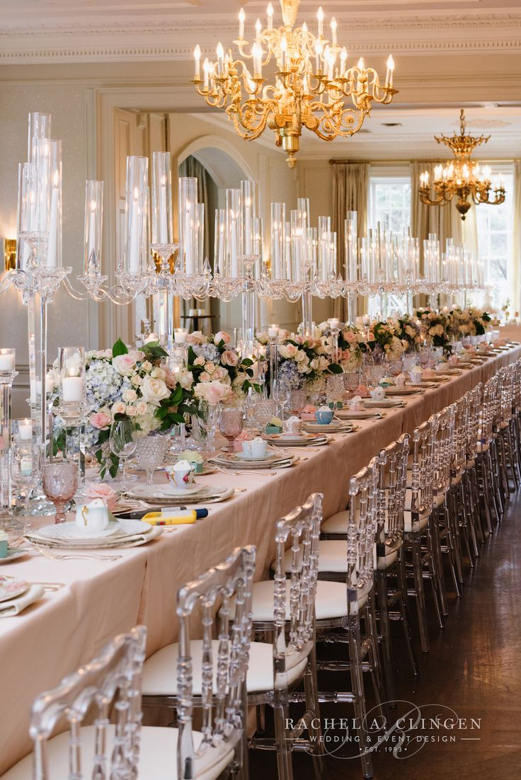 Soft pink and blue floral centrepieces designed by Rachel A. Clingen, line the gallery table at Graydon Hall.