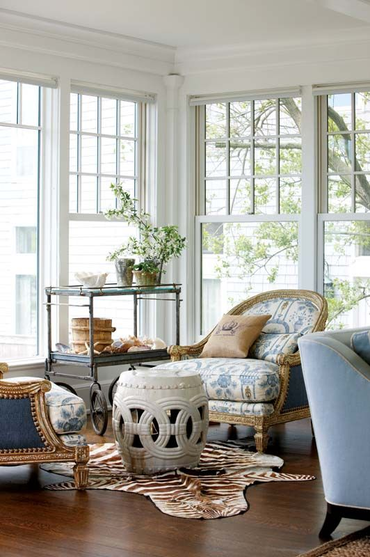 The living room's design started with the blue-and-white toile fabric on the Ralph Lauren chairs.