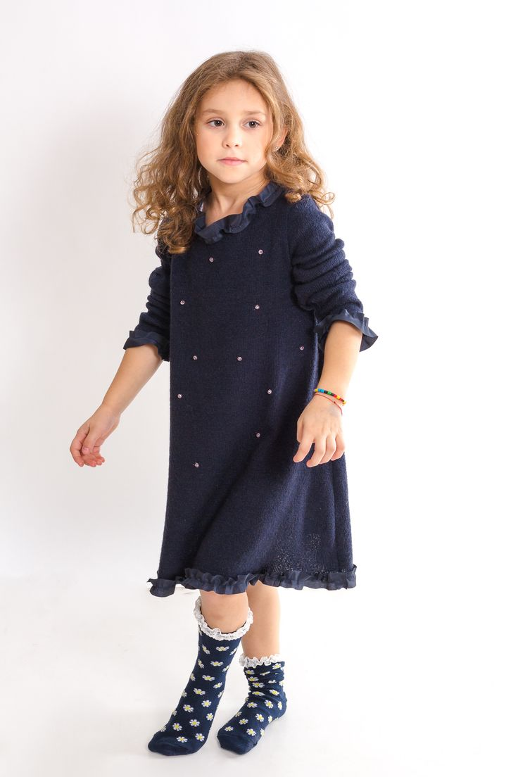 Wool dress accessorized with pink glass bids and silk finishes for fashionable kids. Girls clothes designed by Designers for Kids, a premium brand for children designer clothes...