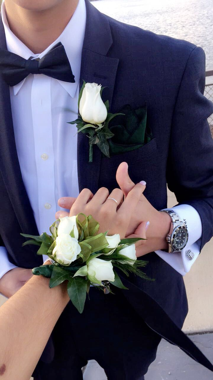 Prom or homecoming matching corsage and boutonniere. Featuring dark forest green band and white sweetheart roses and French tip nails #prom #prompics