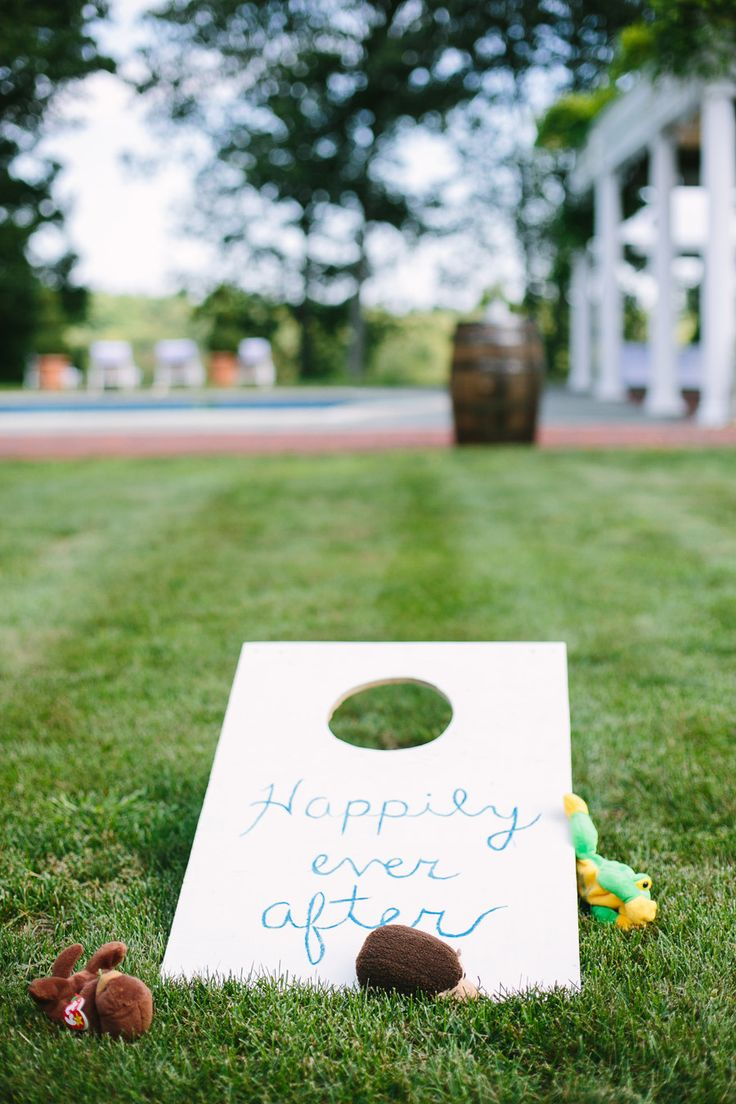 #games, #happily-ever-after, #outdoors  Photography: Lisa Rigby Photography - lisarigbyphotography.com  Read More: http://www.stylemepretty.com/2014/05/13/backyard-cocktail-party-wedding/