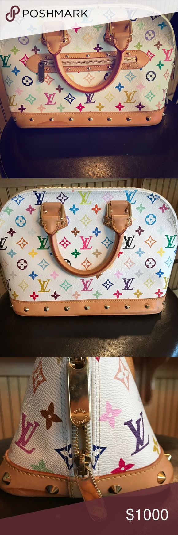 Authentic Louis Vuitton Monogram Multicolor Alma Authentic Louis Vuitton Multicolor monogram Alma bag from the spring 2003 collection. It does have some water stains and wear and tear from over the years. Overall it is a great bag! Height is 15 inches and width is 9 inches. Louis Vuitton Bags
