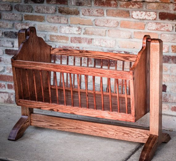 Swinging wooden baby cradle handmade from red oak