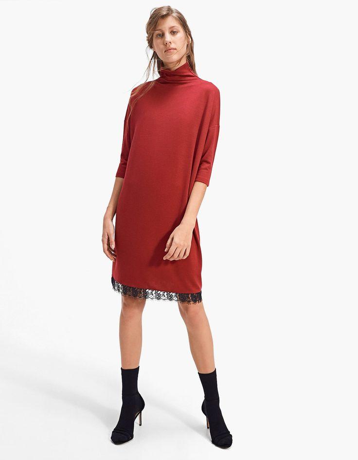 Polo neck dress with lace trim along the hem