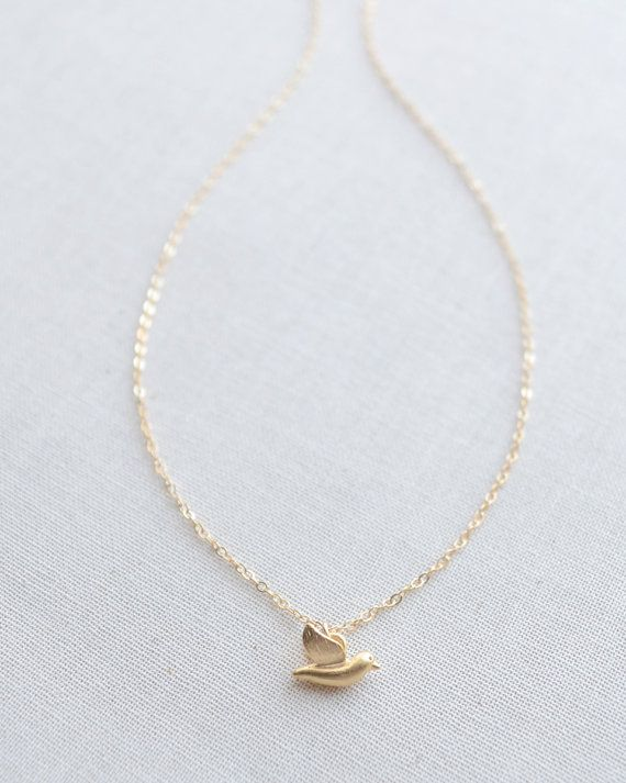 Dainty Bird Charm Necklace by Olive Yew. This tiny bird charm necklace is so cute! The simple gold or rose gold sparrow hangs from a 17 inch chain.