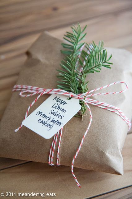 Keep the wrapping for your cookies really simple with kraft paper, baker's twine and a couple of sprigs from your Christmas Tree. (or fresh rosemary). #holidayentertaining