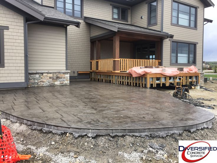 This stamped patio is perfect for the homeowners kids to play on during the summer because it's a nice and smooth texture, and not rough on the feet. #diversifiedconcreteservices #stampedconcrete #yyc #patio #summer #concrete #sealed